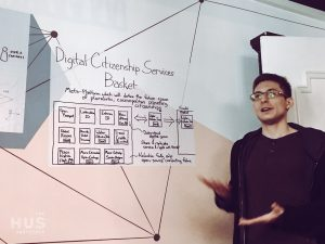 """Anders Aamodt of Holochain presenting the """"Digital Citizenship Services Basket"""" in front of over 20 international guests"""